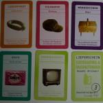 Die Warenkarten und eine Lieferkarte (unten rechts).